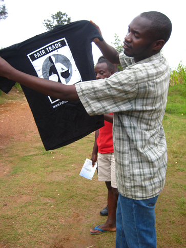 A member of the Abakunda Kawa cooperative in Rwanda proudly displays a Fair Trade Certified T-shirt.