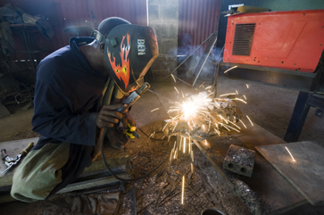 A Wonder Welder's employee puts the finishing touches on a metal pig.