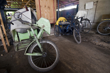 The employee parking lot for donated hand-pedal carts at Wonder Welders.