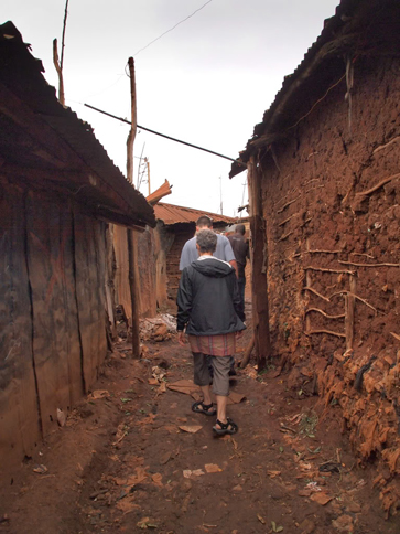 Walking to the Tabitha Clinic. Last year, CFK's garbage collection program served 2,352 Kibera residents, employed 35 young people, and collected 31 tons of trash.